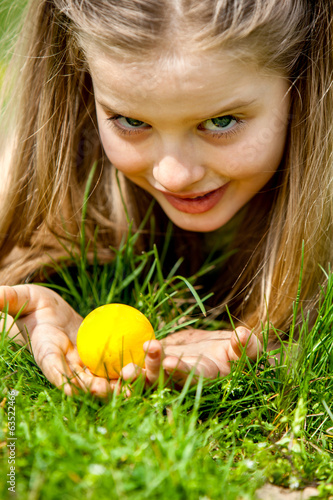 Child find easter egg outdoor.