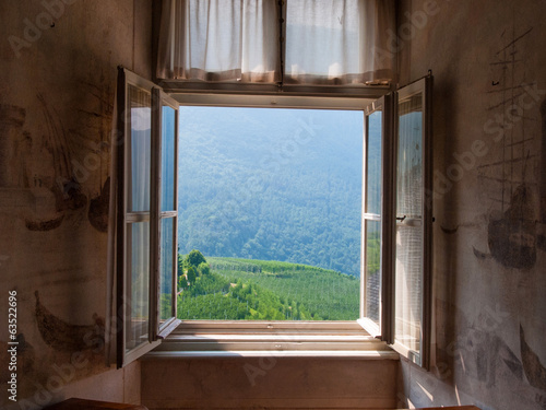 Vineyard via a farm house landscape in Italy