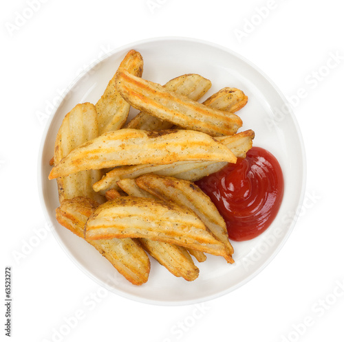 Baked potato wedges in dish with ketchup