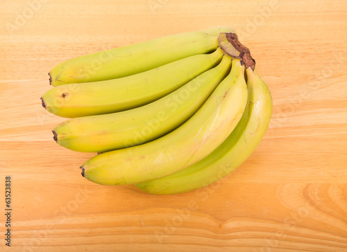 Green Bananas on Wood Table