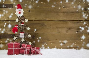 Weihnachtlicher Holz Hintergrund mit Geschenke in Rot
