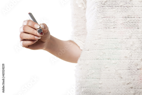 woman's hand writing with a marker in the empty space