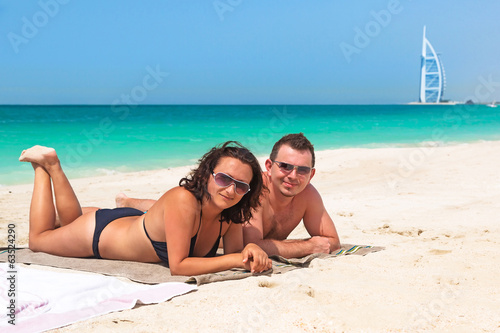 Couple enjoying holidays on the beach of Dubai