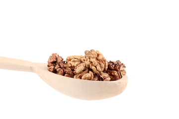Wooden spoon full with walnuts