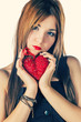 Cute girl holding red heart