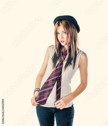 Funny girl in derby hat and colorful tie