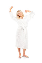 Woman in bathrobe stretching