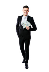 Full-length portrait of a smiling businessman holding US dollars