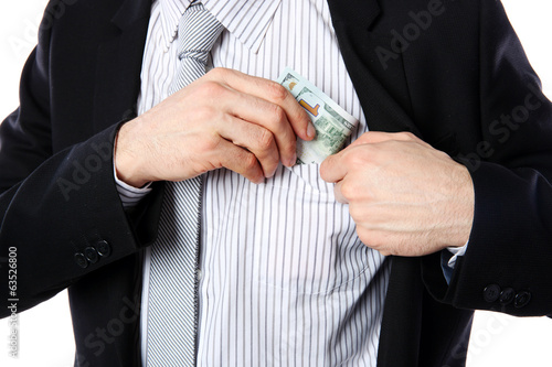 Businessman putting money in pocket isolated on white background