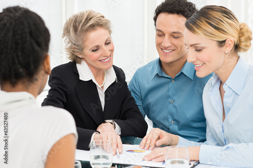 Two Businesswomen Discussing In Meeting