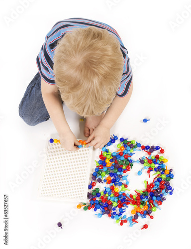 Child plays with a mosaic