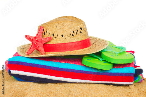 sunbathing accessories and straw hat