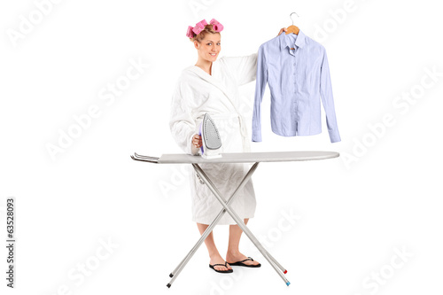 Woman holding a shirt and an iron