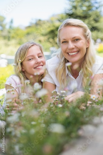 Mother and daughter smiling in park