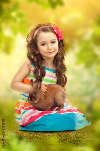 Happy little girl with rabbit