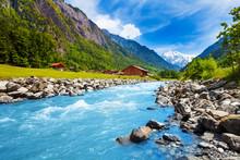 "Постер, картина, фотообои ""Swiss landscape with river stream and houses"""