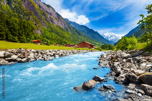 Keuken foto achterwand Europa Swiss landscape with river stream and houses