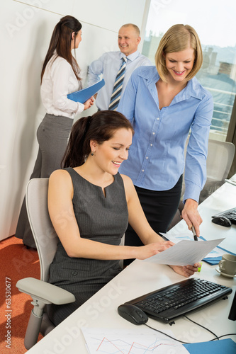 Businesswomen Discussing Document