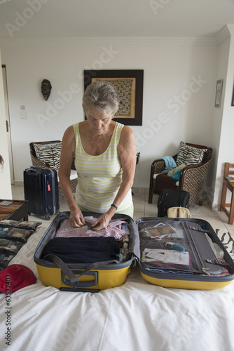 Woman packing a suitcase