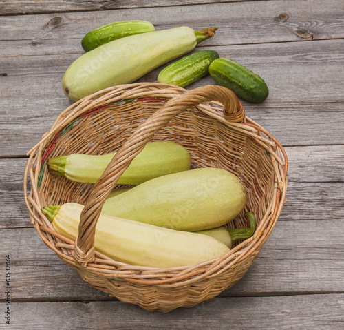Basket with fresh zucchini and cucumber
