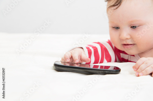 infant touching smart phone, early learning
