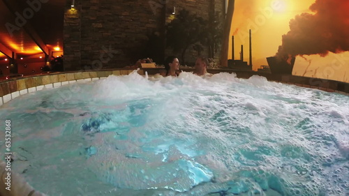 Conceptual video: jacuzzi couple with Industrial Background