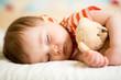 Leinwanddruck Bild - infant baby sleeping with plush toy