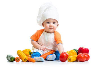 baby chef with healthy  food vegetables