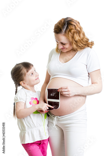 Pregnant woman and her kid daughter reviewing baby ultrasound sc