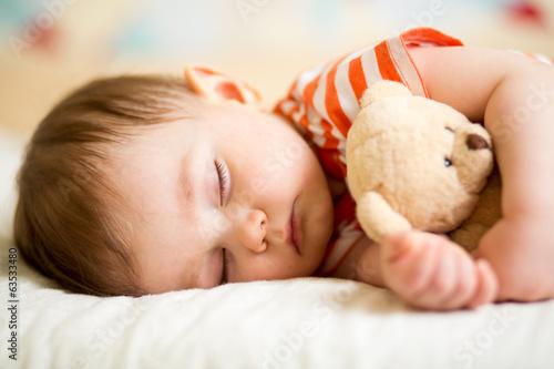 Leinwanddruck Bild infant baby sleeping with plush toy