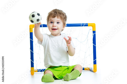 kid football player holding soccer ball