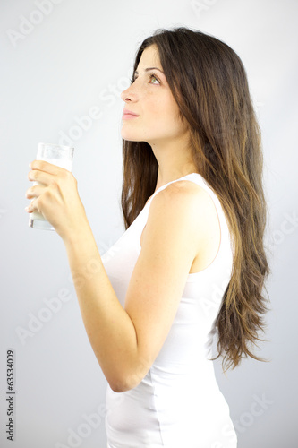 Gorgeous woman holding glass of milky