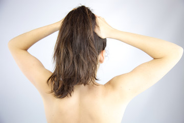 Woman holding hair into ponytail