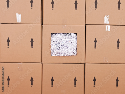 Shredded Paper in Wall of Boxes