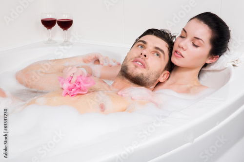Adorable couple in bathroom