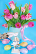 easter decoration with wooden bunny and fresh tulips