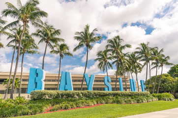Bayside capital letters sign and Palm trees in Miami Florida