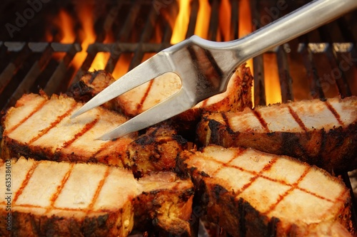 Grilled Steaks on BBQ Grate and Flames in background, XXXL