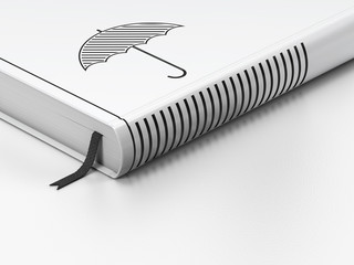 Security concept: closed book, Umbrella on white background