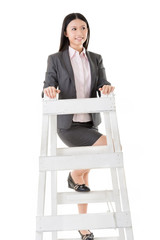 Asian business woman climb a ladder