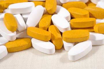 Heap of white and yellow pills