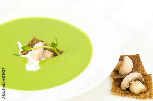 pea soup on a white dish at restaurant