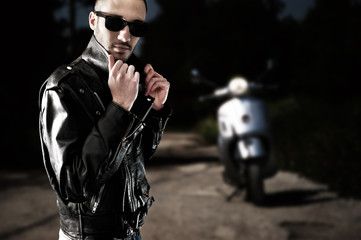 Biker on leather jacket and sunglasses