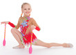 little girl exercising with gymnastic mace