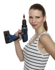 Young craftswoman with a power drill