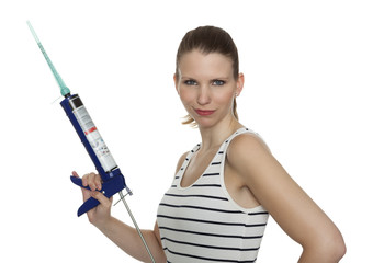 Young craftswoman with a caulking gun