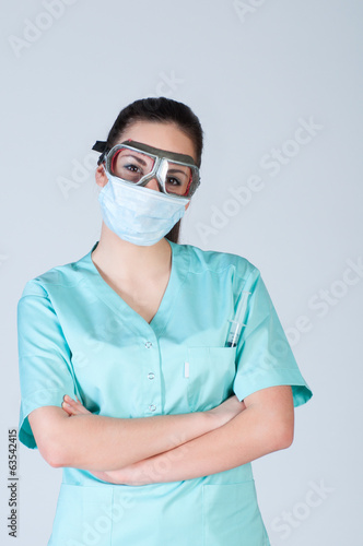 Nurse or doctor in pilot glasses with mask