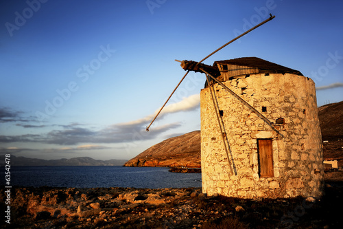 Windmill on sunset in a Greek island