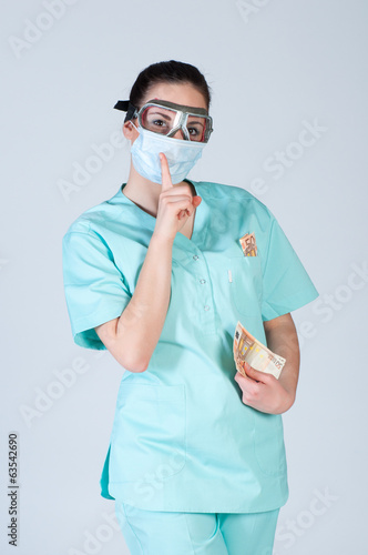 doctor in pilot glasses with mask and money