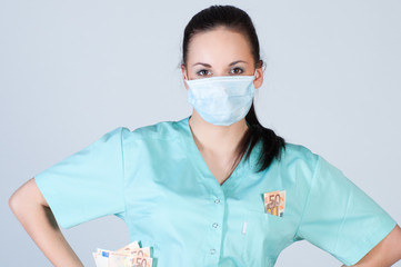 Nurse or doctor wearing  mask and holding money